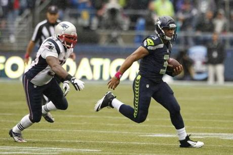 Seahawks quarterback Russell Wilson ran from Patriots linebacker Jerod Mayo in the second half.